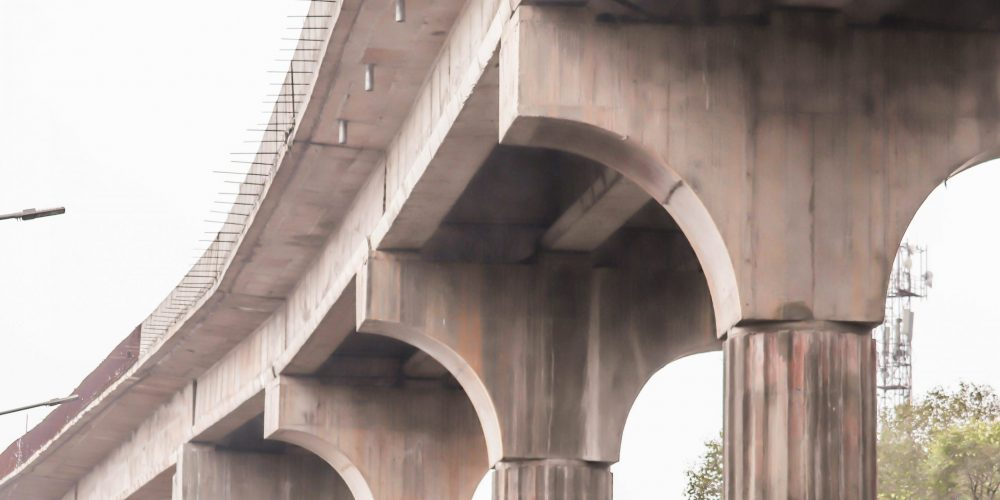 An Under Construction Cement Concrete Columns Iron Flyover Bridge With Pillars In India